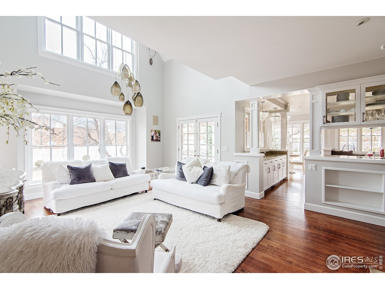 Sun drenched living room with built ins, vaulted ceilings+