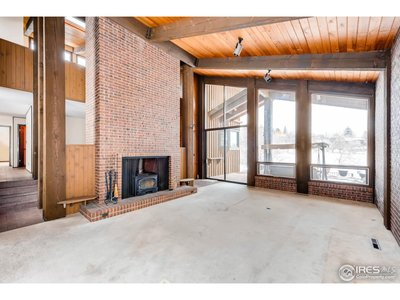 Large Living Room with Beams & Tons of Glass