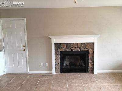 LIVING ROOM WITH TILE FLOORING, FIREPLACE