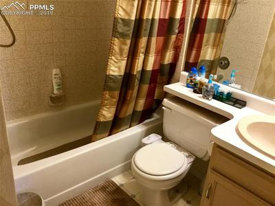 Updated bath on upper level that services both bedrooms.
