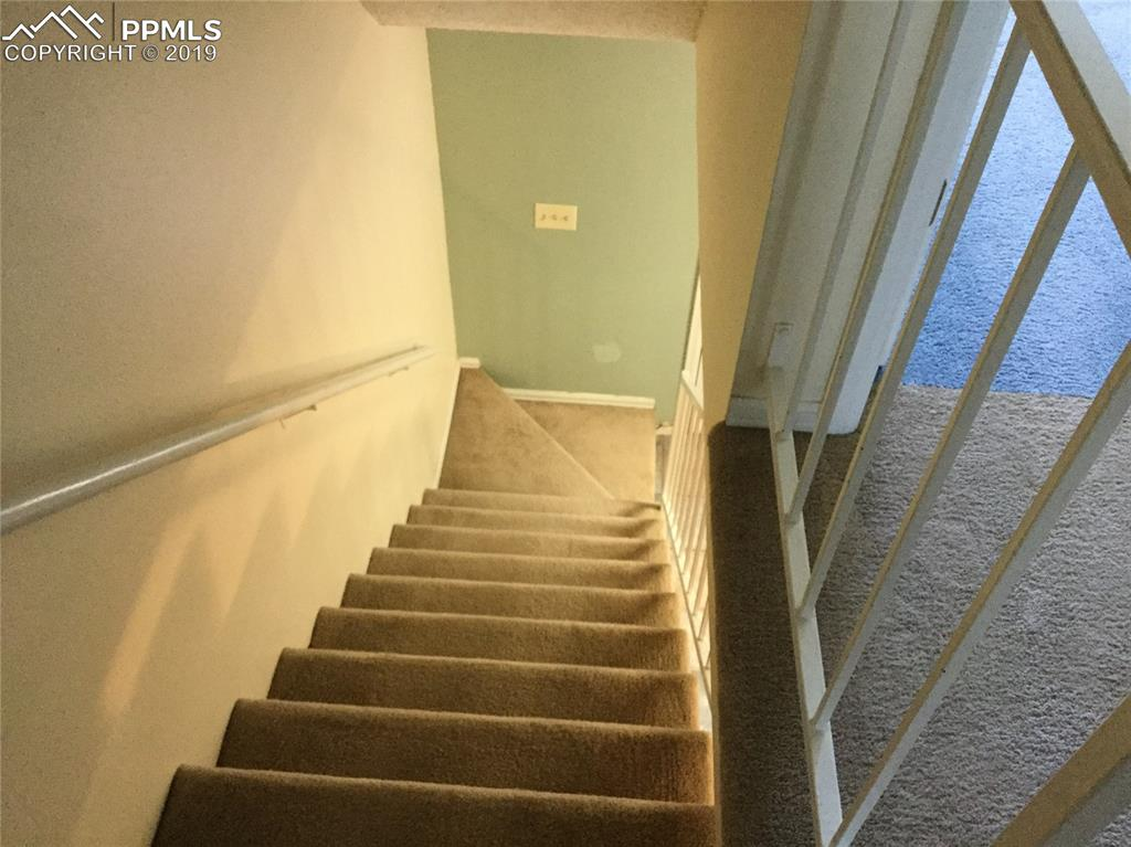 Stairs going from upper level to main.