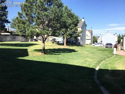 Spacious green space behind the unit.  The pool is on the north side of the complex.  Water is included in the HOA.
