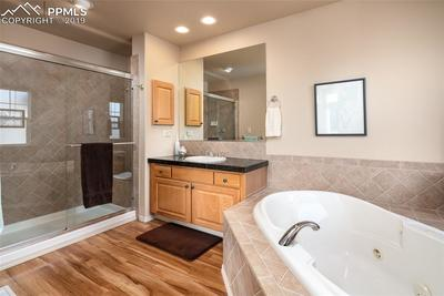 Master bath.  Double vanities with granite counters, jetted tub, shower and wood