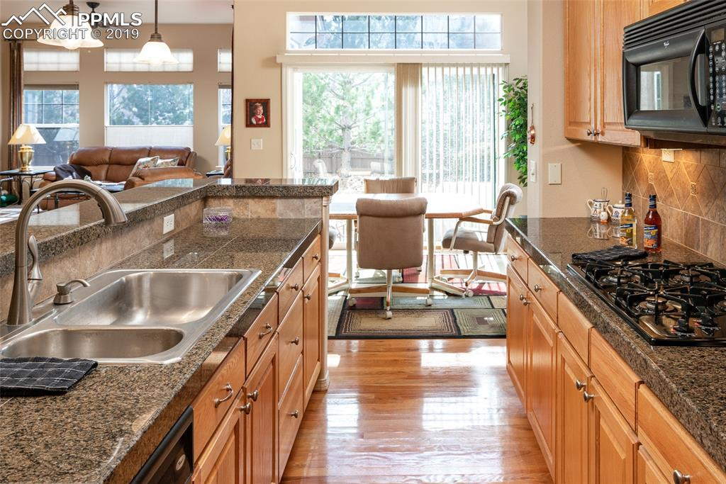 Wood Floors, Granite Counters, Under Cabinet Lighting, Gas Range and Walkout!