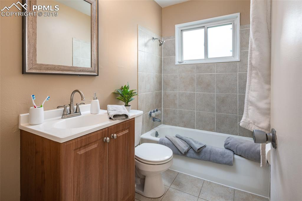 Bathroom with tile shower and floors
