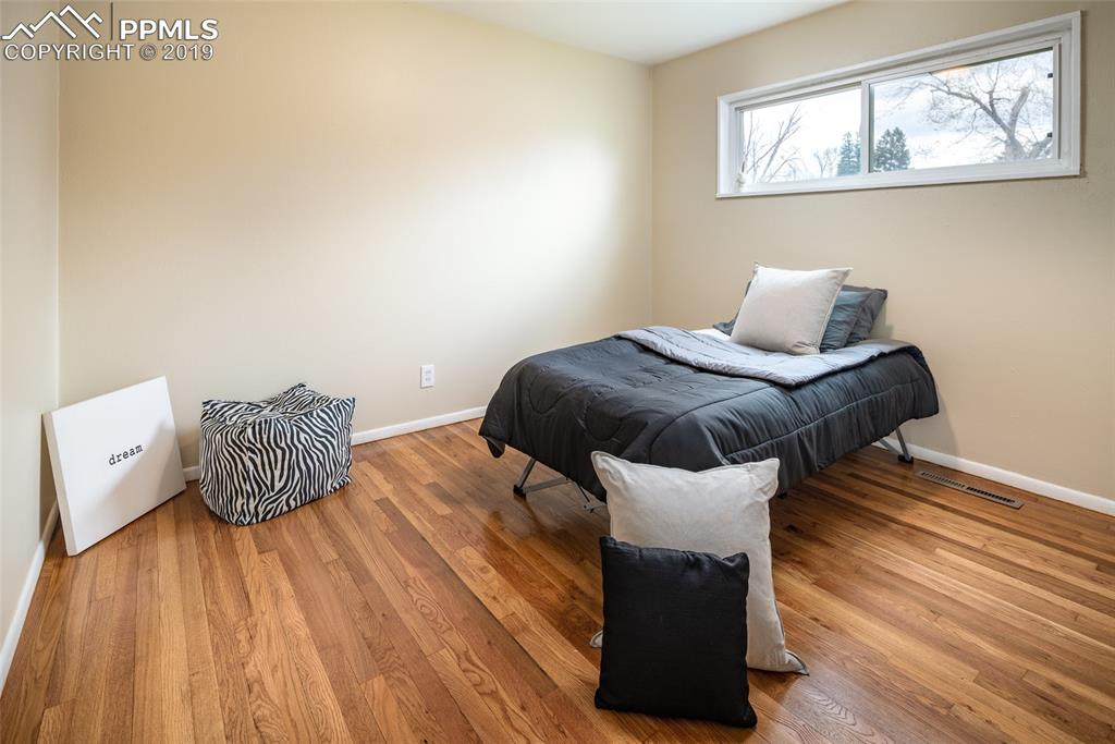 Bedroom with hardwood floors and fresh paint