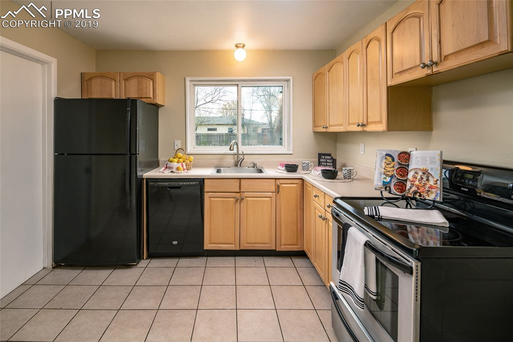 Spacious kitchen with tile floors; Lots of cabinets and counterspace!