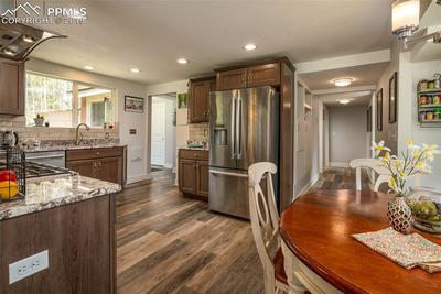 Kitchen with eat in nook; hallway to master bedroom, main bath and main level bedroom