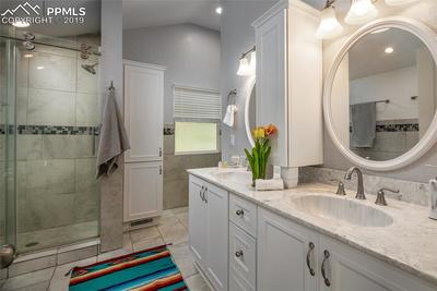 Spacious, bright and open main level bathroom; Double vanities, beautiful claw foot tub, updated shower and plenty of storage!