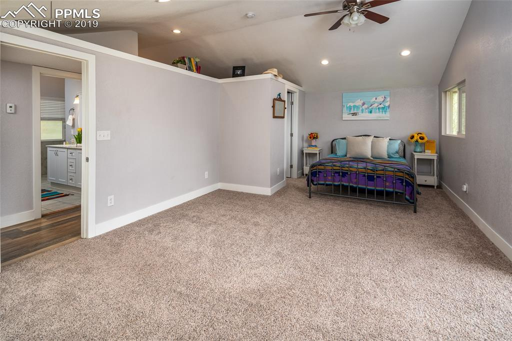 Huge master bedroom with large walk-in closet, vaulted ceilings, newer carpet, fresh paint and recessed lighting