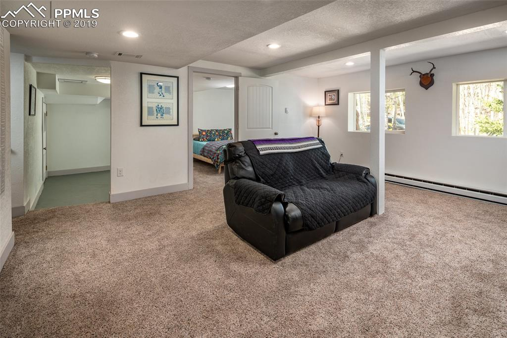 Basement living area with view to mud room and bedroom
