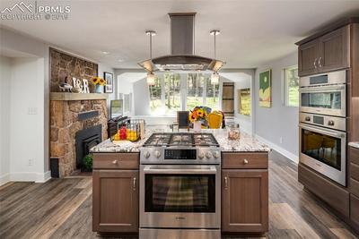 Upgraded stainless steel appliances, open concept living and views all around!