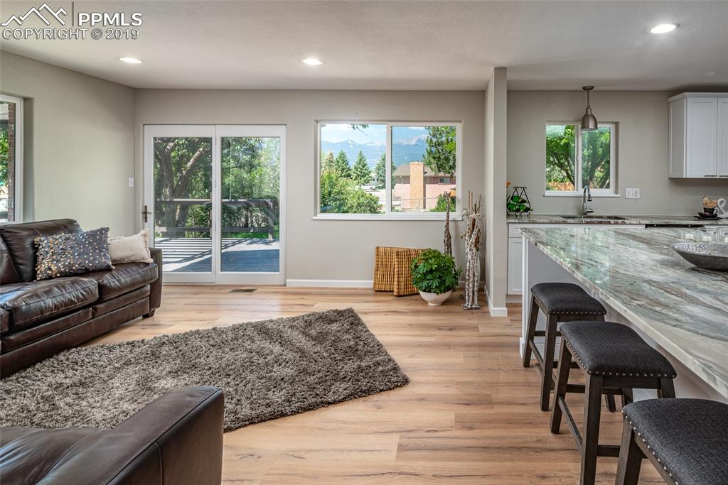 Main level living room with walkout to backyard deck and great view of Pikes Peak!