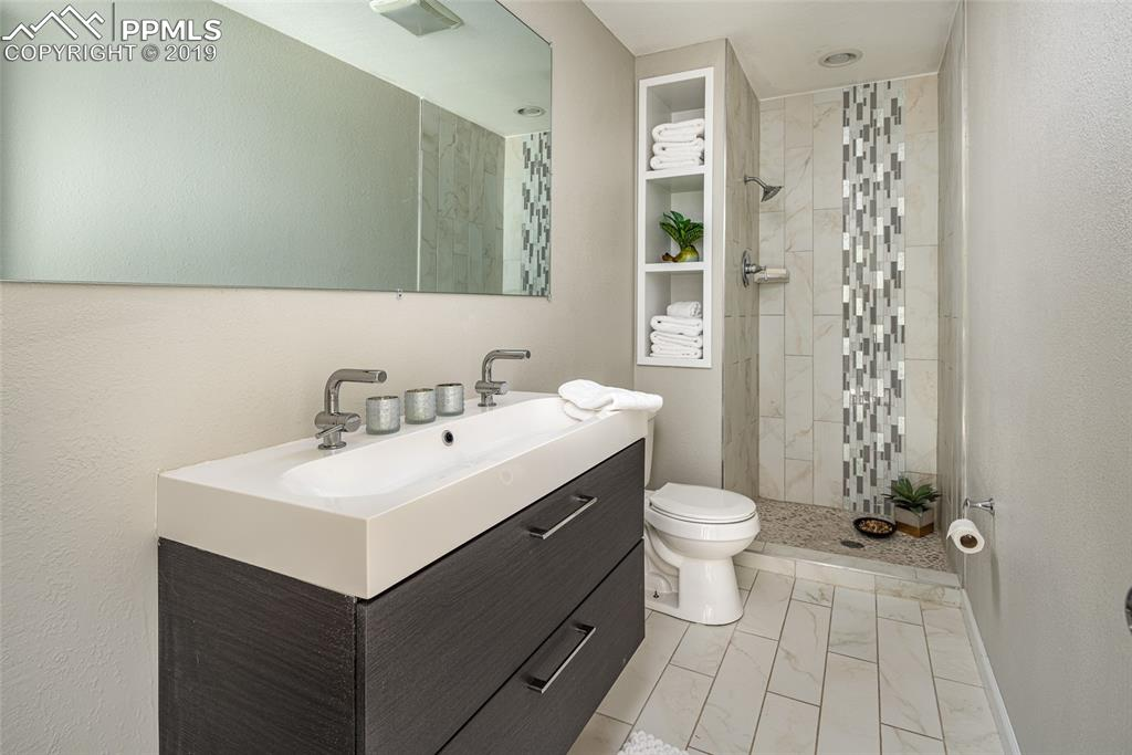 Master bath with brand new paint, tile flooring, double vanities and beautifully tiled shower