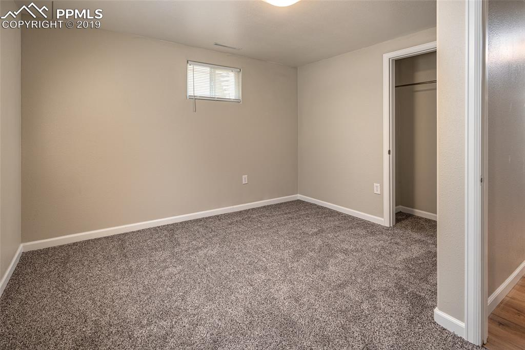 Basement bedroom with brand new paint, flooring and lighting