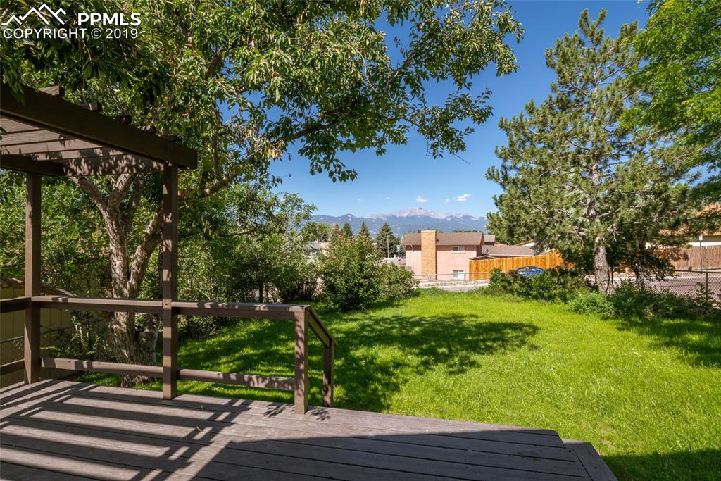 Walkout deck with access from living room; view of Pikes Peak and plenty of mature trees and easy to maintain landscaping