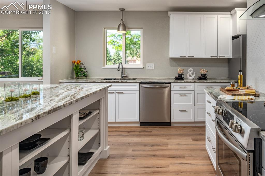 Beautiful white cabinets with self-closing drawers and stainless steel appliances