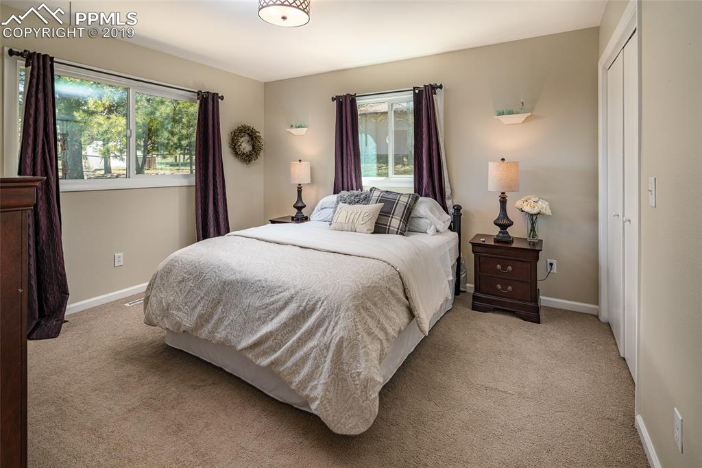 Large master bedroom with plenty of windows to keep it nice and bright.