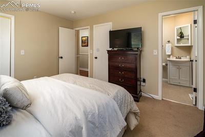 Master bedroom with adjoining master bathroom.