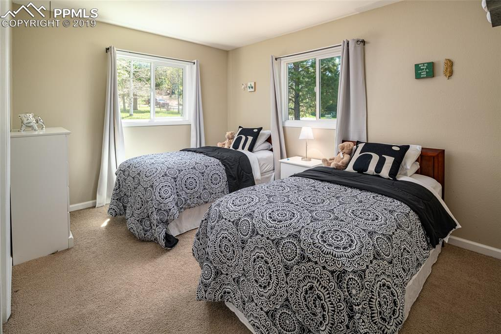 A third bedroom with big windows.
