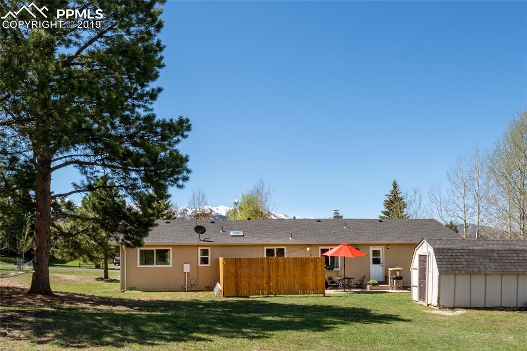 Expansive back yard that feels spacious, peaceful and has a great 'over the roof top' view.