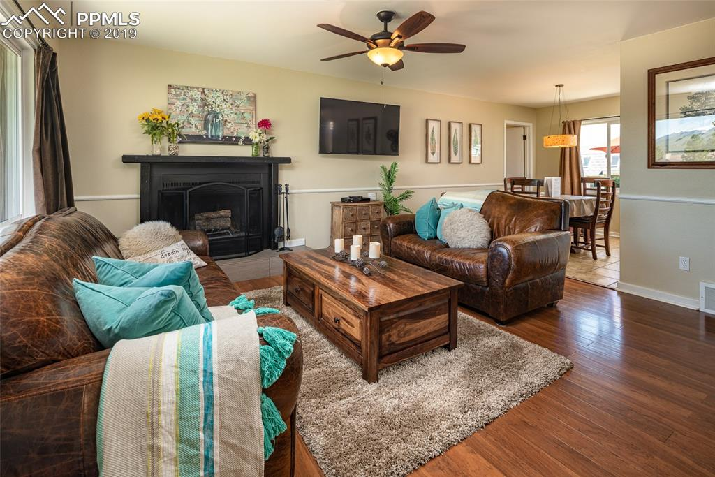 Family room with wood burning fireplace and nice open concept with family room to dining area.