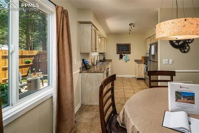 Dining to kitchen with a great view into the backyard.