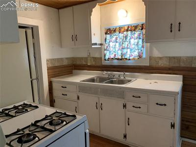 Vintage kitchen with outdoor access and window to enjoy spacious backyard