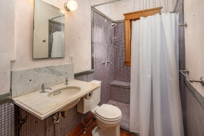 Updated main level bath with walk in tile shower.