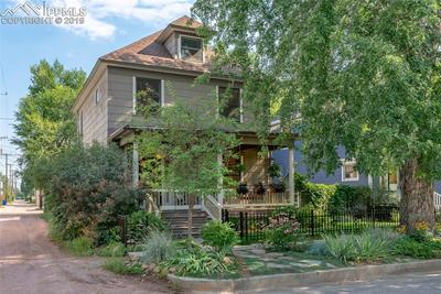 Summer time view of this gorgeous Victorian home with alley access.