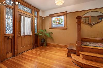 Original flooring and the original stained glass entry as well as the gorgeous o