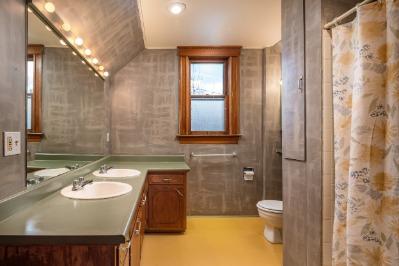 Upper level bath with dual sinks.