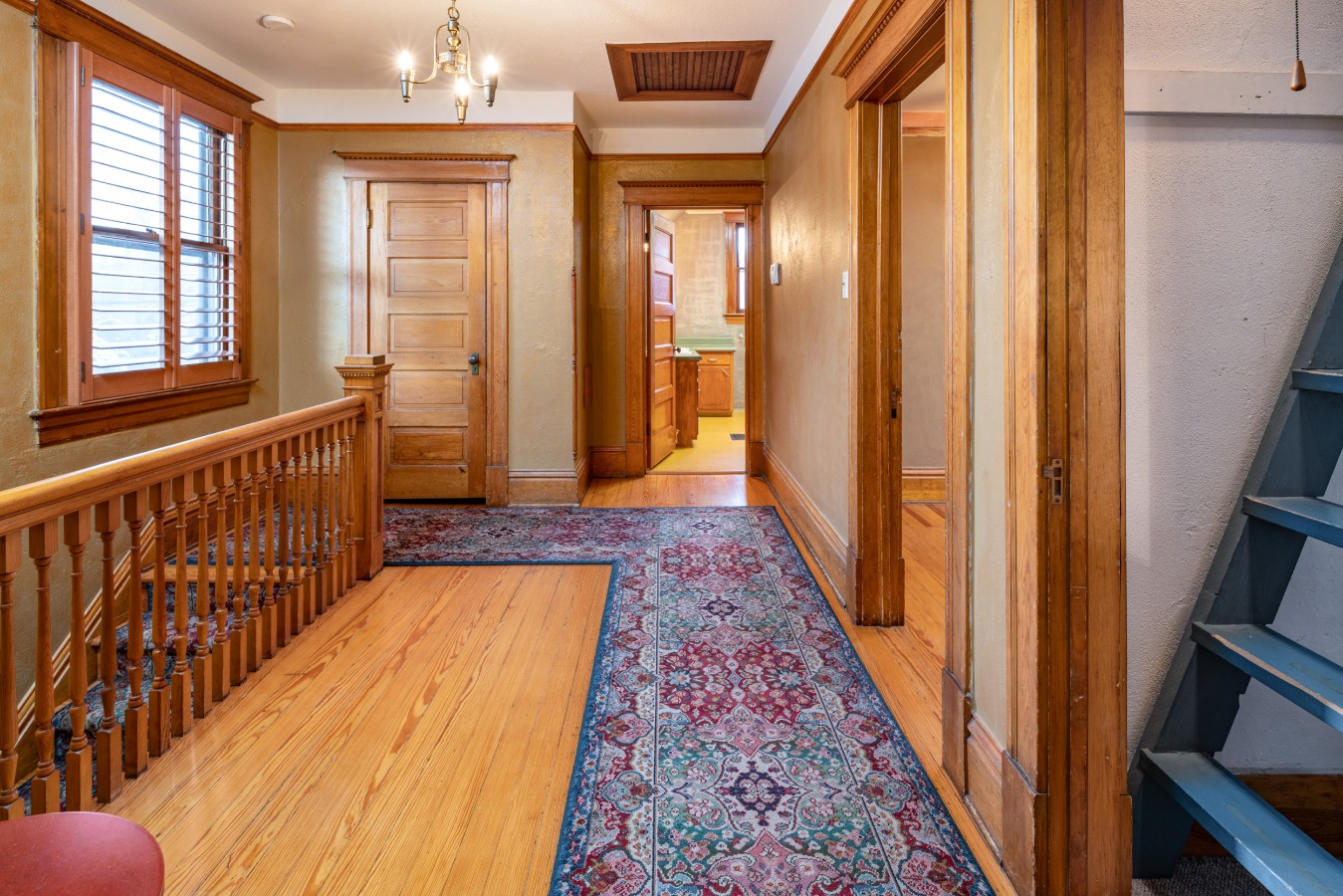 Wide upper level hall...upper level bath as well as attic access to the right.