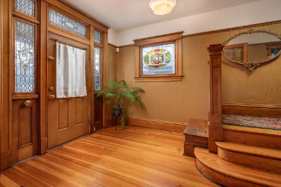Original flooring and the original stained glass entry as well as the gorgeous original woodwork!