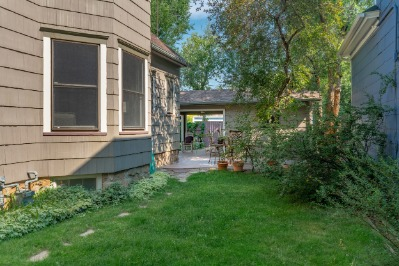 Grassy side yard extends the outdoor living space.