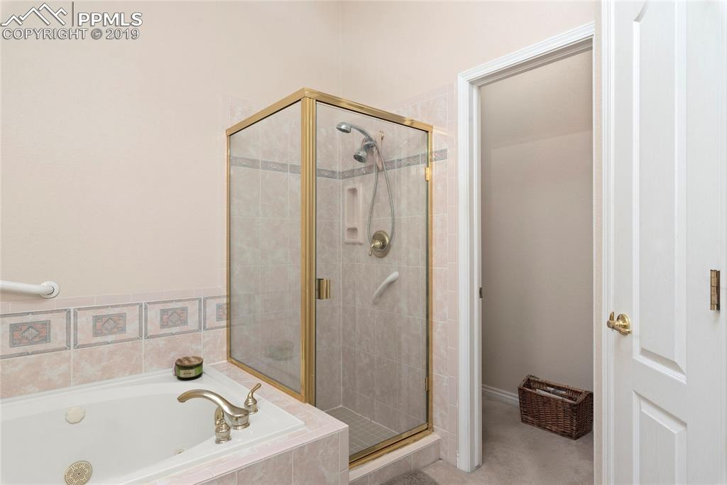 Master bath with jetted tub and free standing shower.
