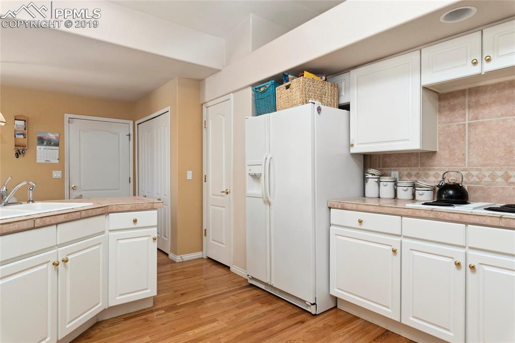 Spacious kitchen with wood floors, lots of counter space and storage.