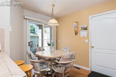 Informal dining off kitchen with access to outside.  Door leads to 2 car attached garage.