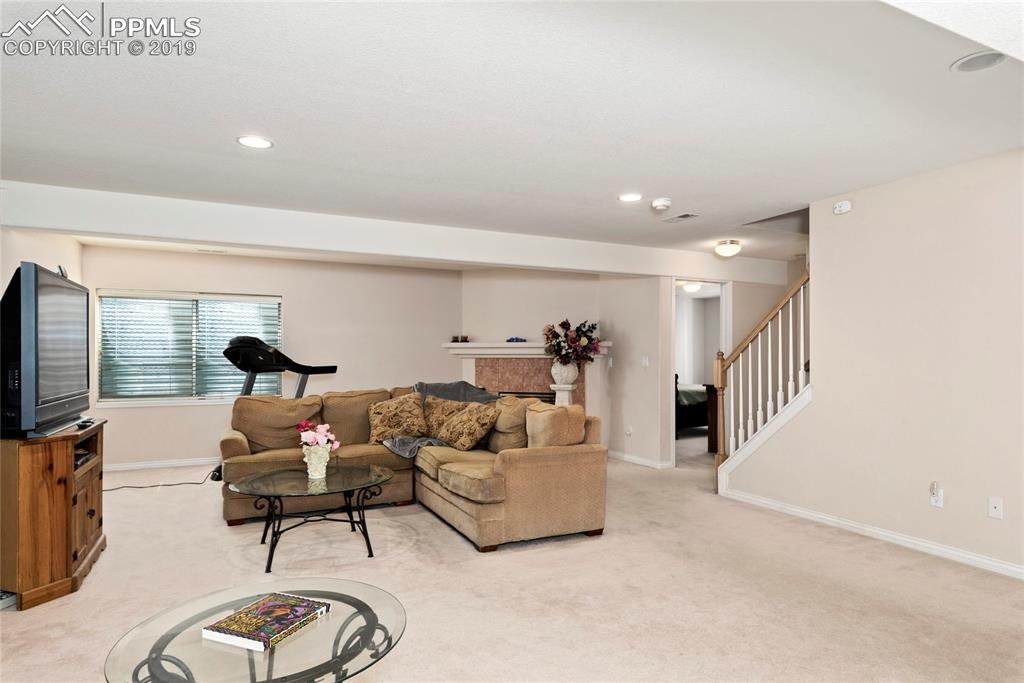 Basement family rec room with gas fireplace.