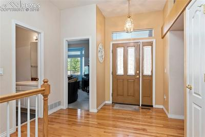 Spacious entry with wood floors.