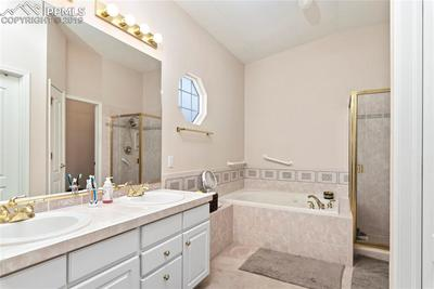 5-piece master bath with jetted soaking tub, free standing shower and walk in closet.