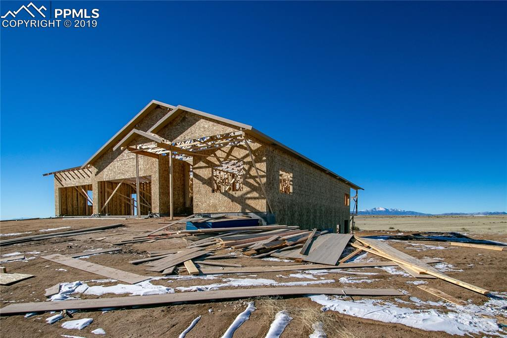 Stunning Walkout Stucco Rancher with Pikes Peak Views
