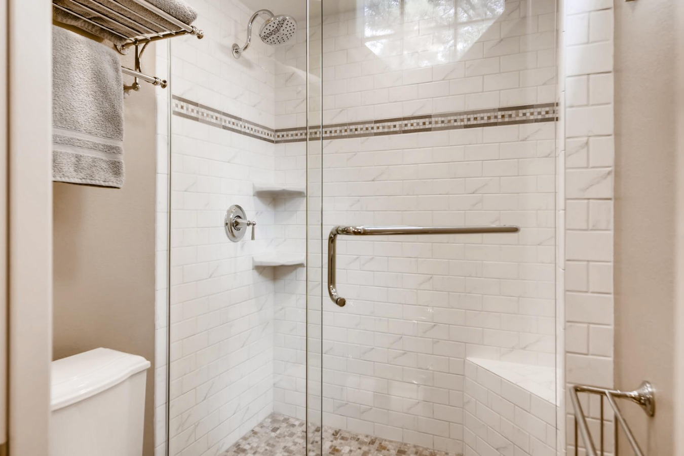 Updated master shower with bench