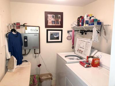 INTERIOR LAUNDRY + TANKLESS WATER HEATER