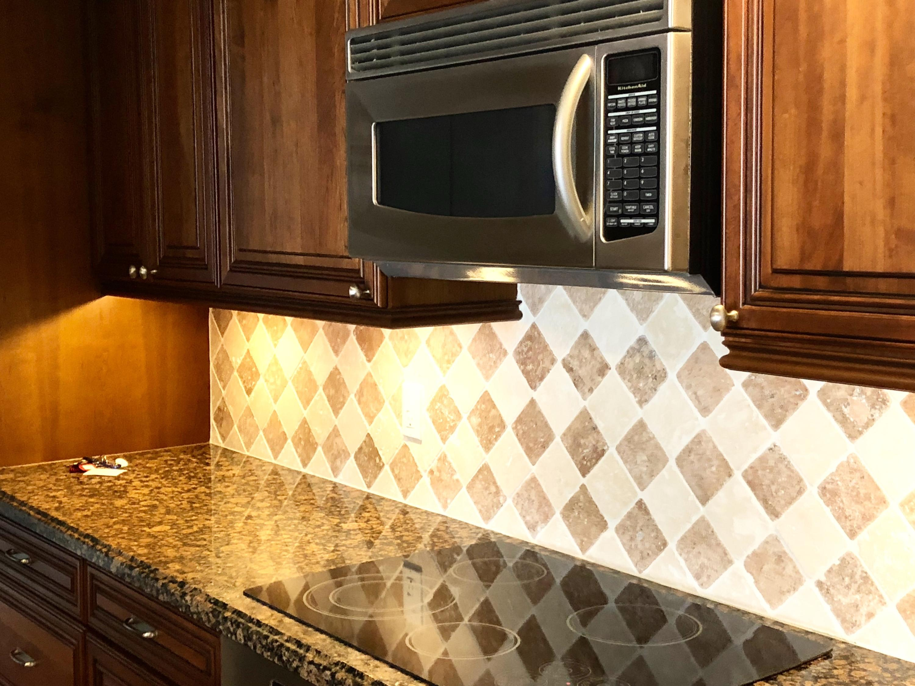 CUSTOM WOOD CABINETRY AND BACKGPLASH