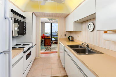 CHEERFUL WHITE GALLEY KITCHEN