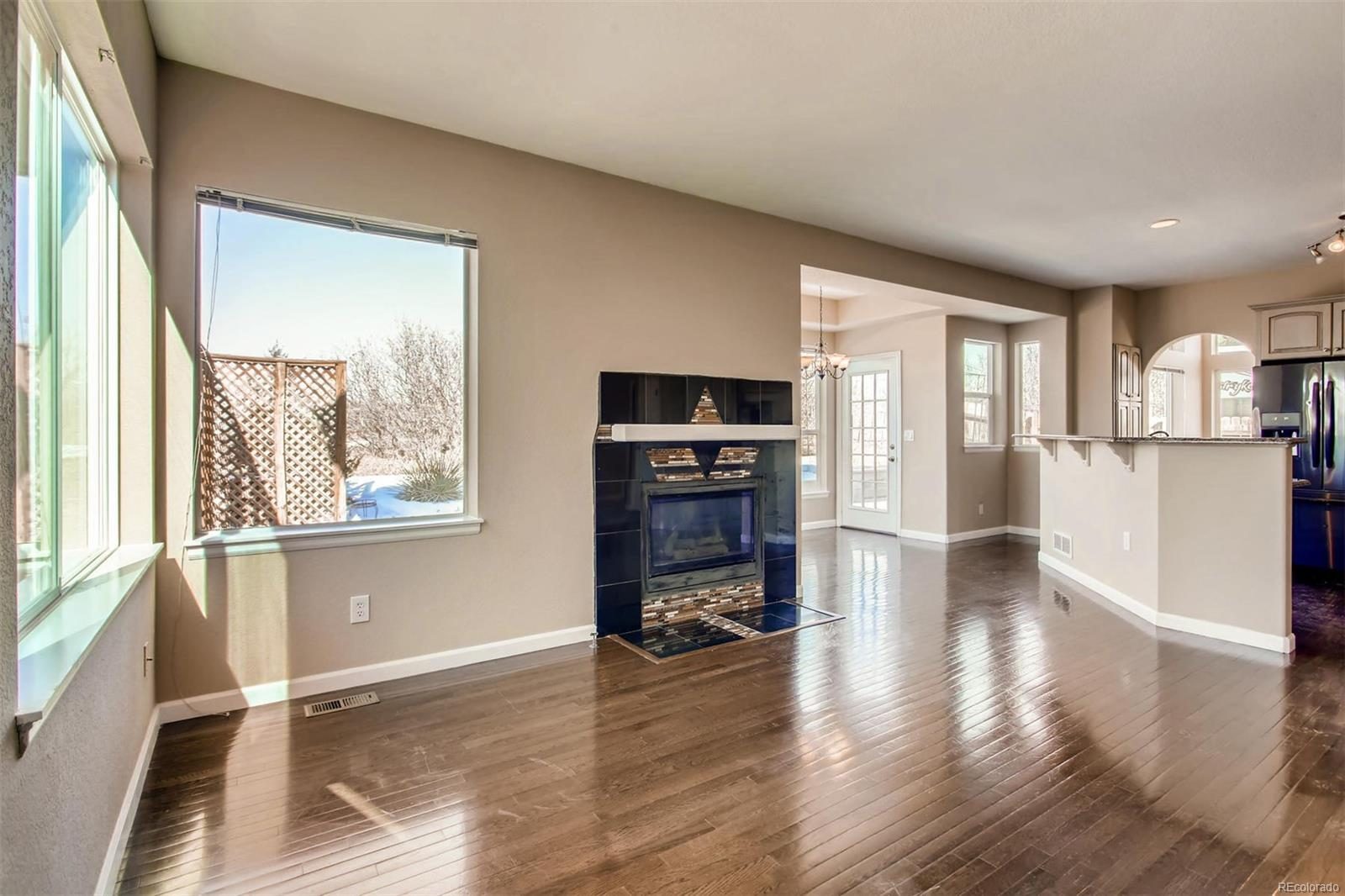 View of Fireplace, Family Room, Dinette, and Kitchen Island