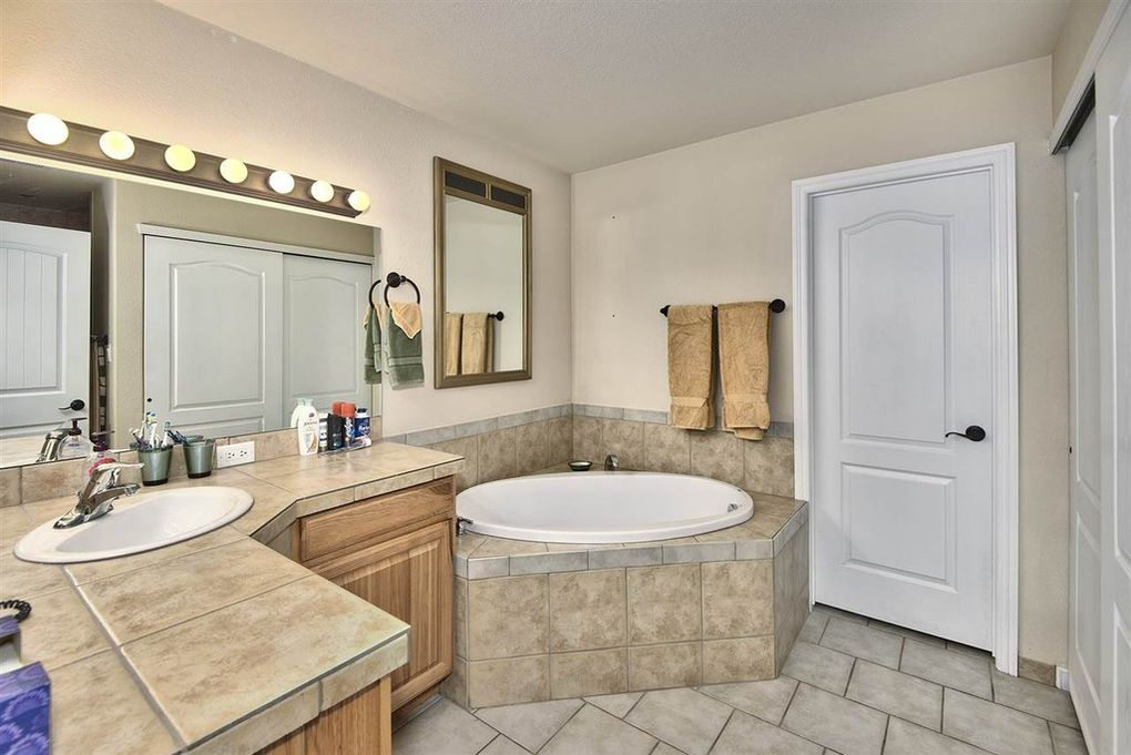 Master bath with soaker tub and tile counters