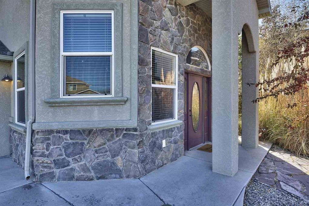 The stucco and stone exterior is eye catching!