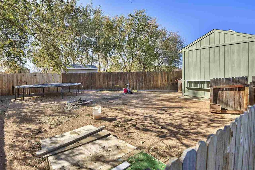 Divided back yard. Dog area or your new garden?
